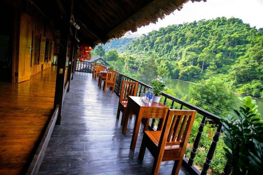 Chairs and tables on the balcony at Mr Linh's Homestay, Ba Be Lake