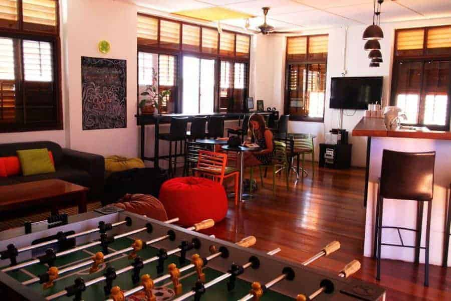 A table football setup and a seating area at Syok Hostel, Georgetown, Penang