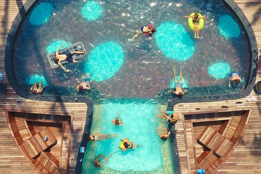 A mushroom-shaped pool seen from above at Begadang Backpackers, Gili Air