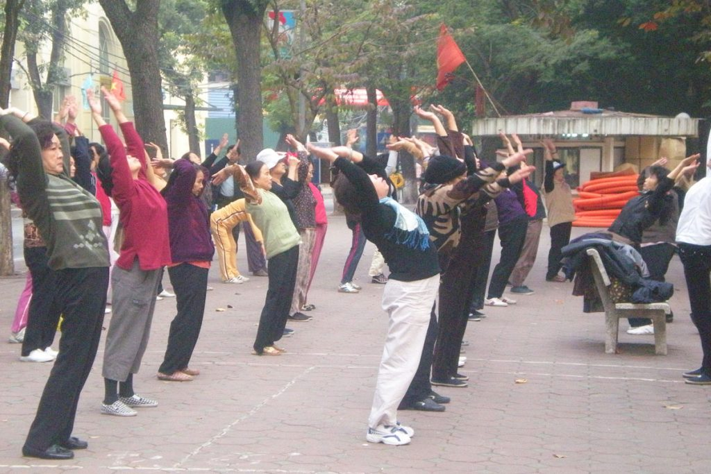 Locals practise the morning aerobics session in Hanoi, Vietnam