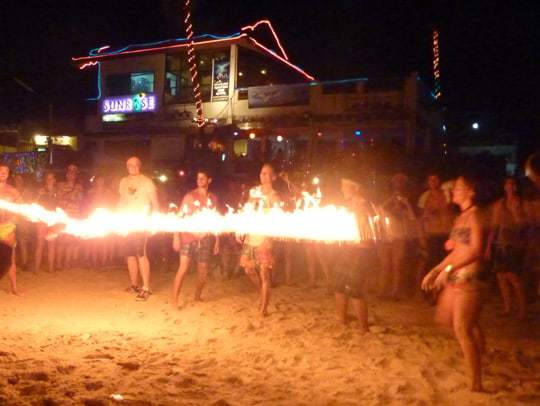 Preparing to jump fire at the Full Moon Party in Thailand