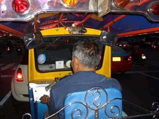 In the backseat of a tuk tuk in Bangkok