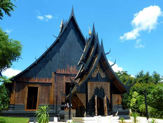 Thawan Duchanee's Black House standing tall against the blue skies of Chiang Rai