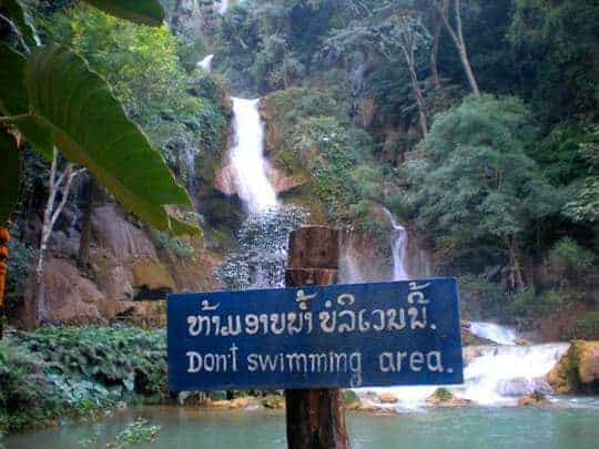 A No Swimming Sign at a Waterfall in Laos