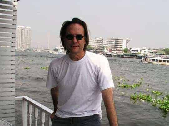 Joe Cummings with the backdrop of Chao Phraya River Bangkok