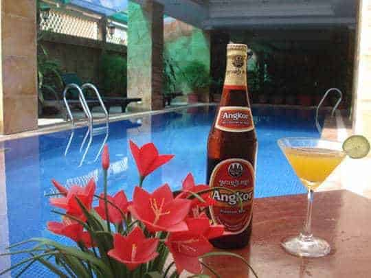 Relaxing by the swimming pool at Ancient Angkor Hotel