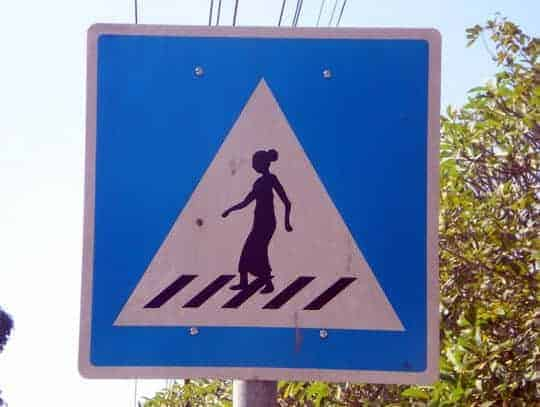 Laotian woman crossing road