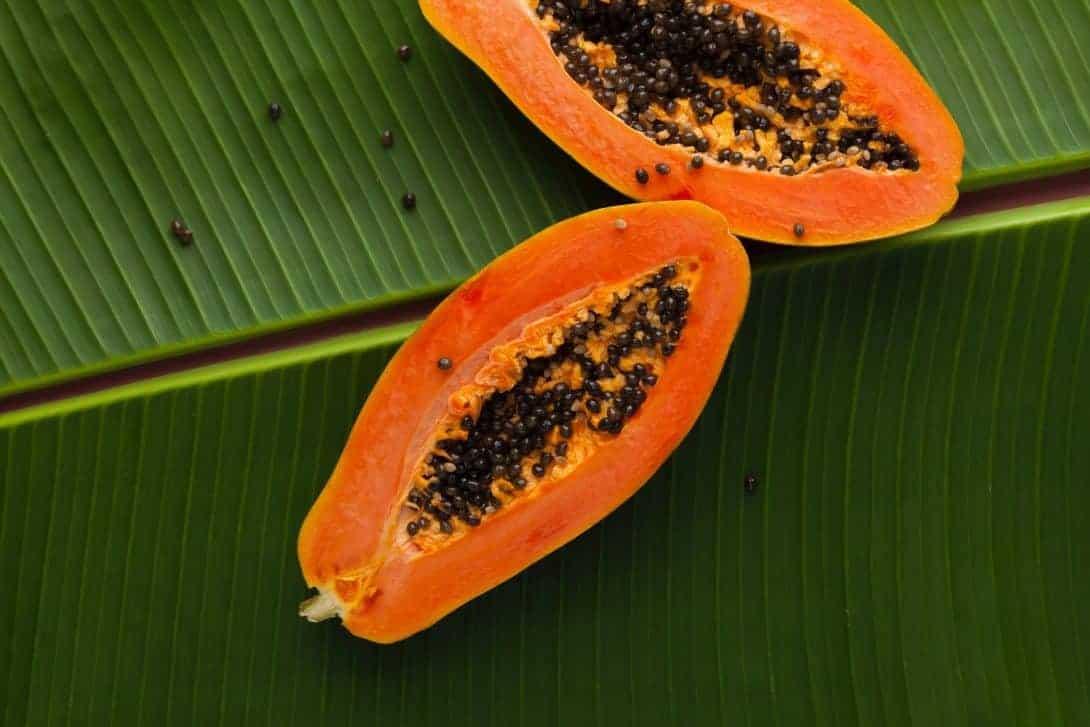 A Papaya on a banana leaf