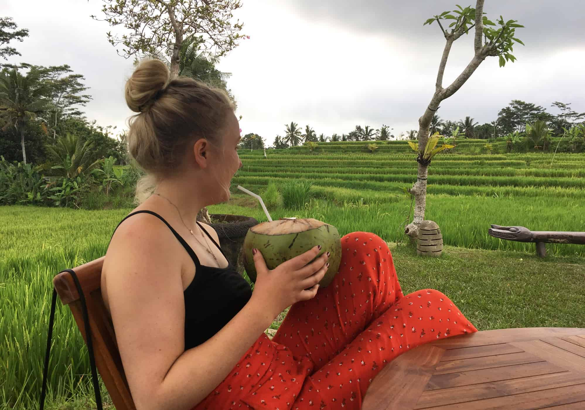 Sipping a coconut in Bali, Indonesia.