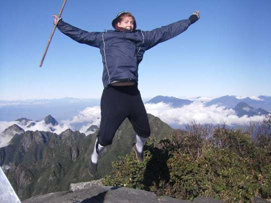 Jumping for joy to have reached Vietnam's highest peak!