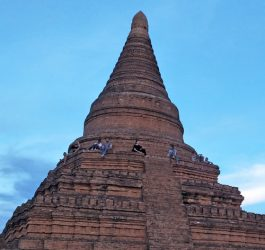 Backpackers climbing temples at sunset, Bagan.
