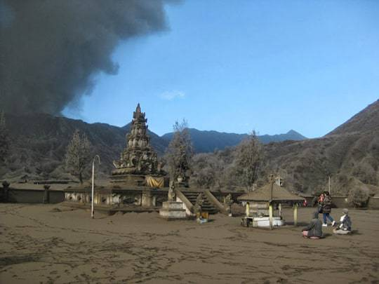 Locals praying in the direction of Bromo