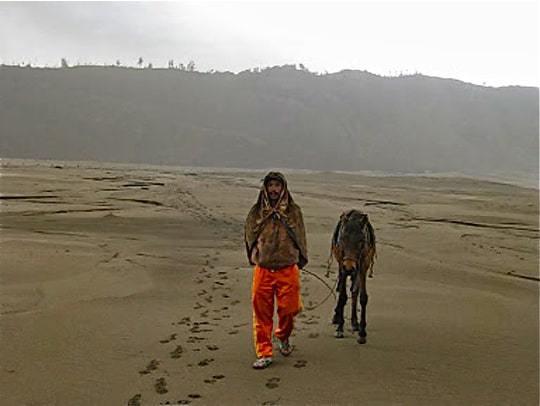 Man and donkey following us edit