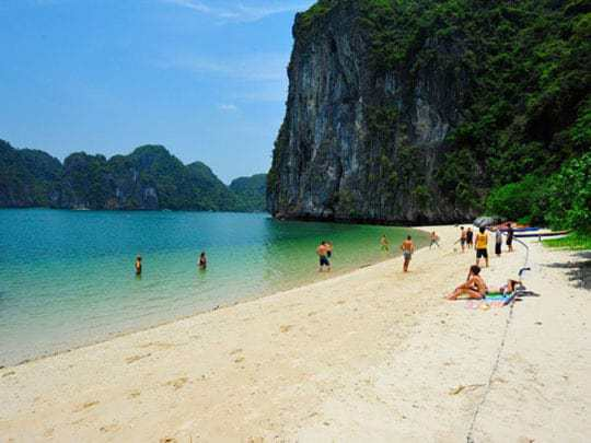 Tourists enjoy the beach at Halong-Bay-Castaways-Island
