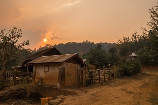 The Sun Sets Behind Wooden Shacks in Hsipaw