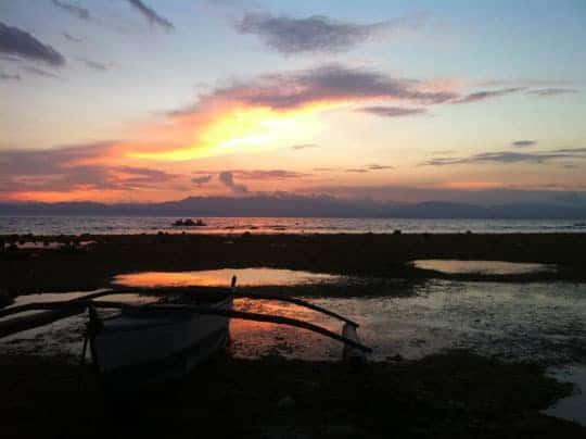 The sun sets over Pangsama Beach, Moalboal Philippines