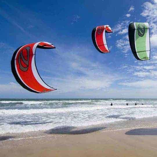 Three kite surfers at the beach in Mui Ne