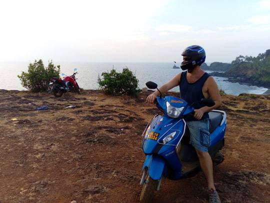 Dave on a Scooter by the Cliffs Near Cabo de Rama Fort