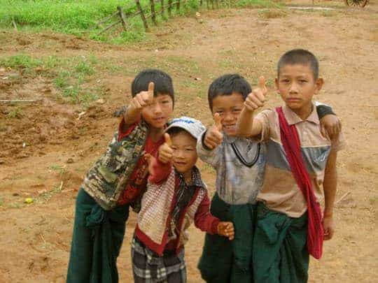 "Local kids give a ""thumbs up"" on the trek from Kalaw to Inle Lake."
