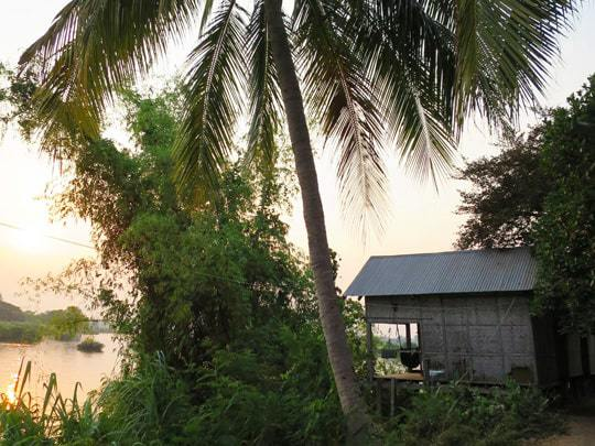 Bamboo hut next to the water Four Thousand Islands