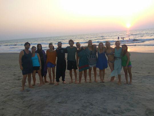 yoga teachers at the beach, becoming a yoga teacher in India