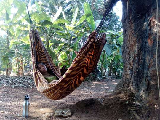 girl in a hammock whilst becoming a yoga teacher in India