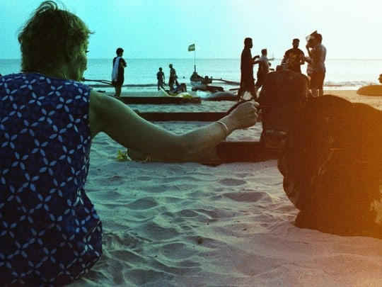 Woman ob beach with cow in Goa. Analog photography