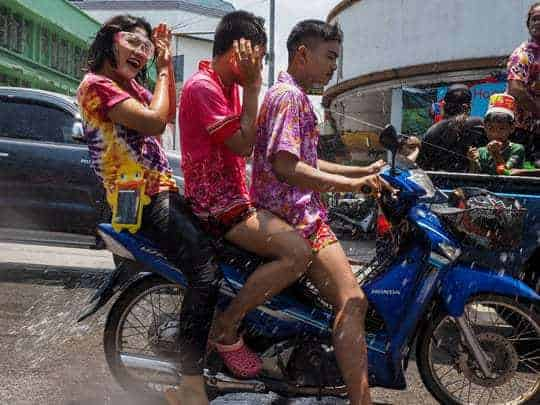 How to survive Songkran - don't ride a motorbike!