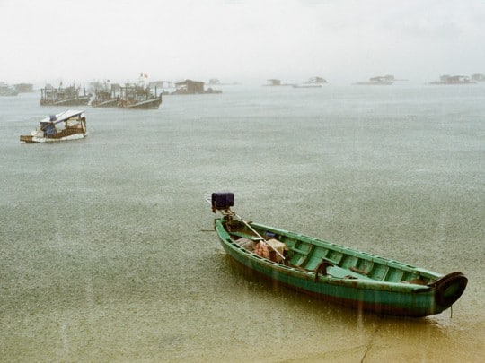 Boats in the rain in Vietnam. Analog photography