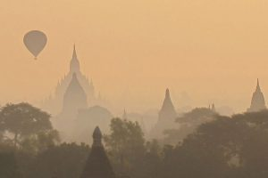 A hot air baloon above a temple in Bagan Myanmar