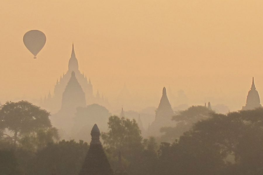 A hot air balloon above a temple in Bagan Myanmar