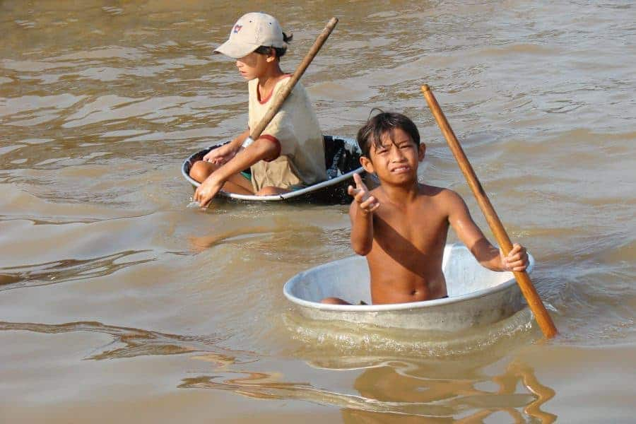 Child beggars at Chong Kneas Floating Village, Cambodia.