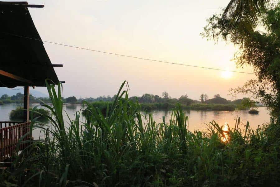 Sunset over the river in Don Det, Laos.
