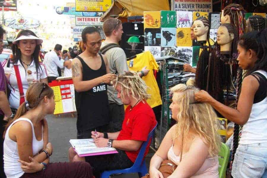 Two Backpackers Getting Dreadlocks on Khao San Road
