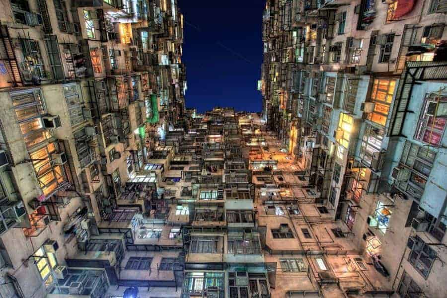 The view up between three sides of buildings in Hong Kong
