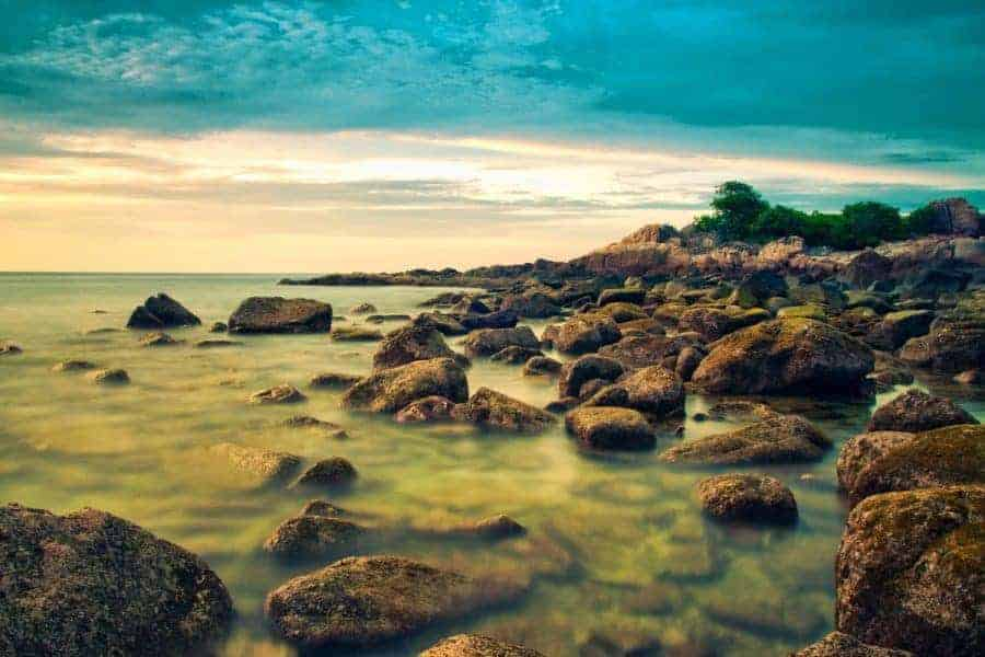 Rocks and shimmering water on the Perhentian Islands, Peninsular Malaysia