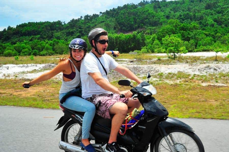 Two backpackers motorbiking on the Buffalo Run with Vietnam Backpackers.