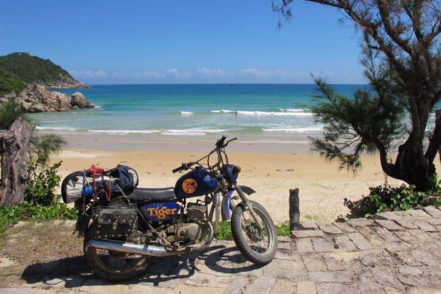 A Motorbike Next to the Beach