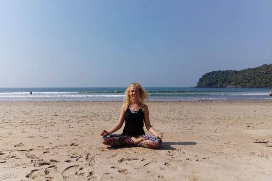 Yoga teacher on beach
