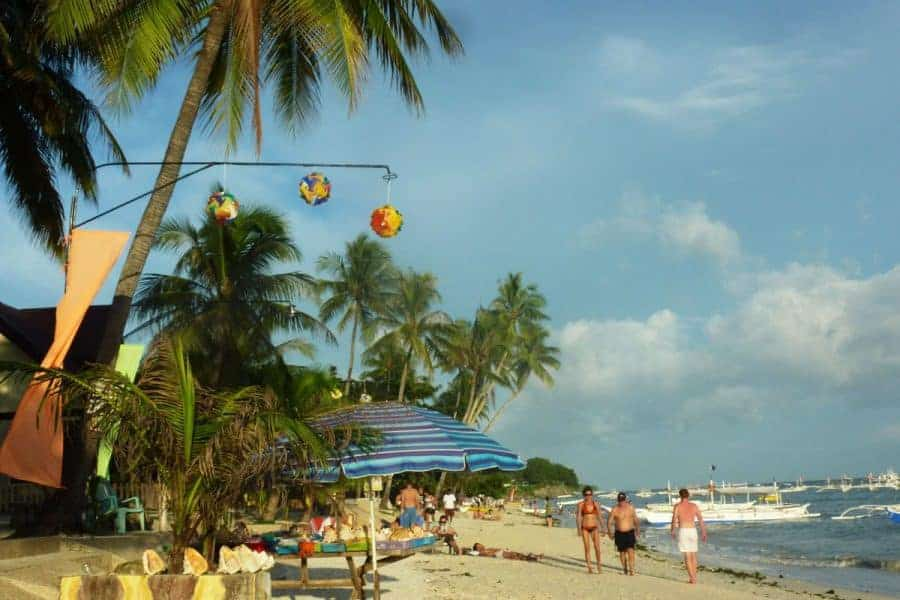 Sun-bathers, tourists and sand on the beach on Panglao Island