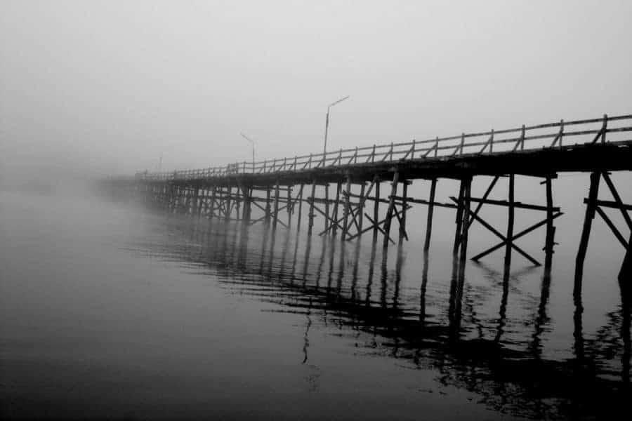 The wooden bridge at Sangkhlaburi seen in the mist