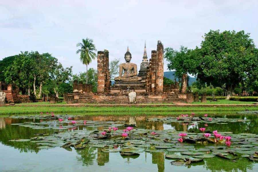 Buddha statue across a pond in Sukhothai