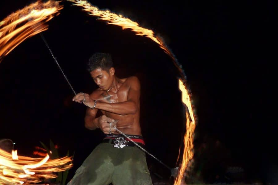 Man dances with fire in Thailand