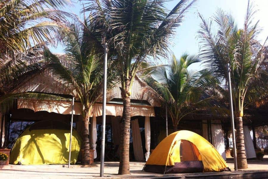 Tents right on the beach at Longson Mui Ne Campground Resort