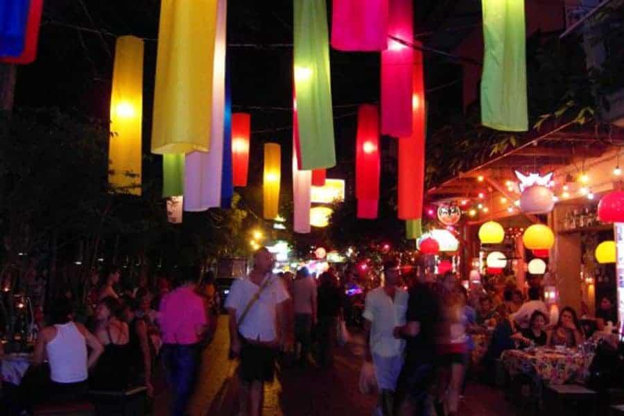 A crowded Bangkok street at night
