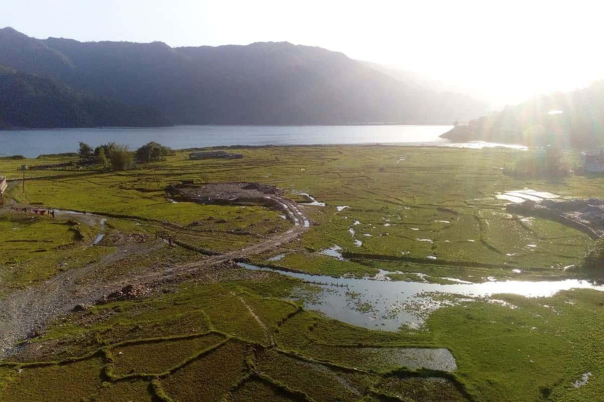 View across rice paddies onto the lake in Sedi Bagar, Pokhara, Nepal