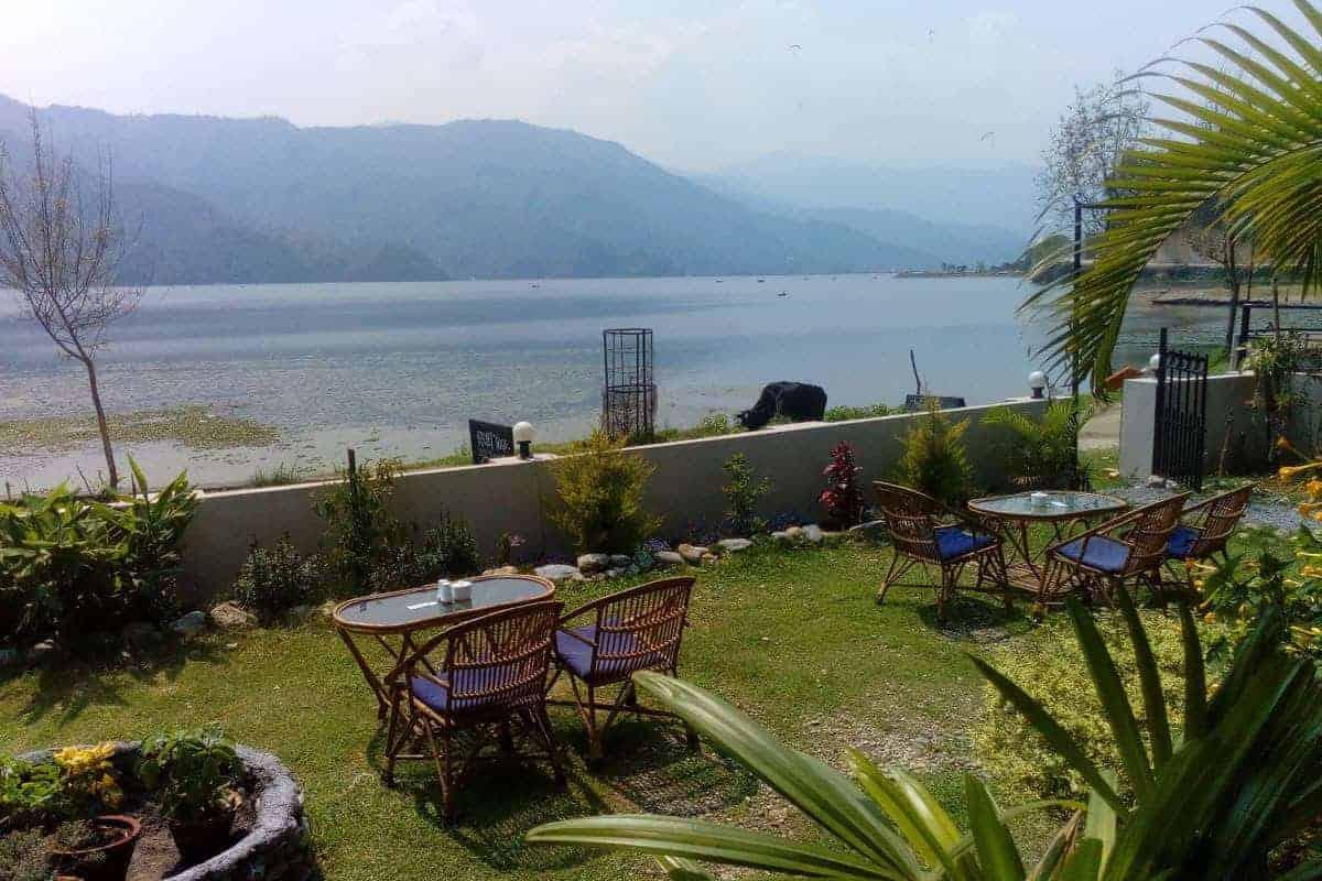 View over Phewa Lake seen from inside Deja Vu restaurant, Pokhara, Nepal