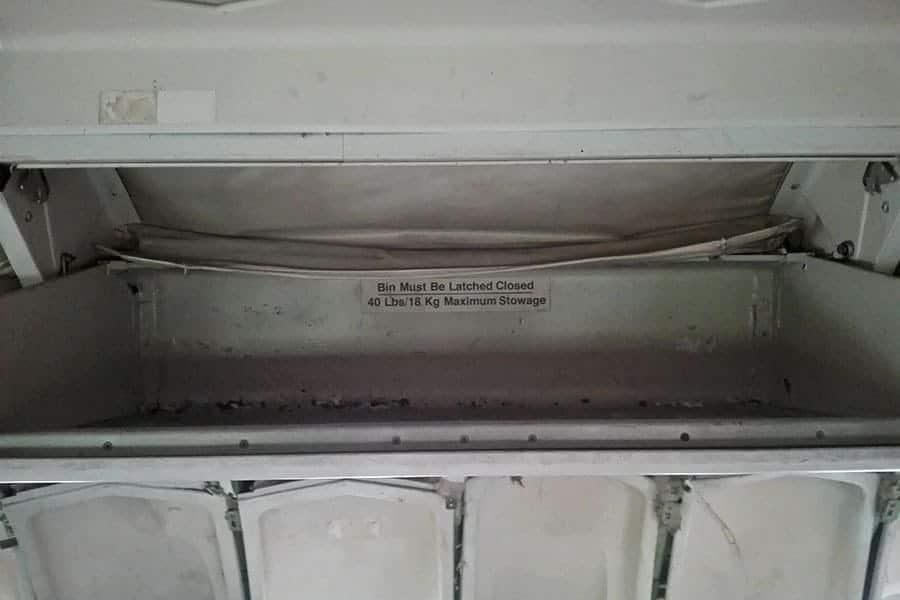 Inside-an-overhead-locker,-aeroplane-graveyard,-Bangkok,-Thailand