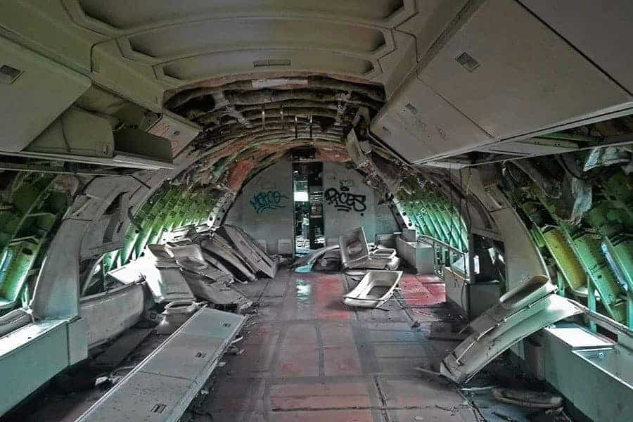 Inside-the-body-of-abandoned-MD-82,-aeroplane-graveyard,-Bangkok,-Thailand
