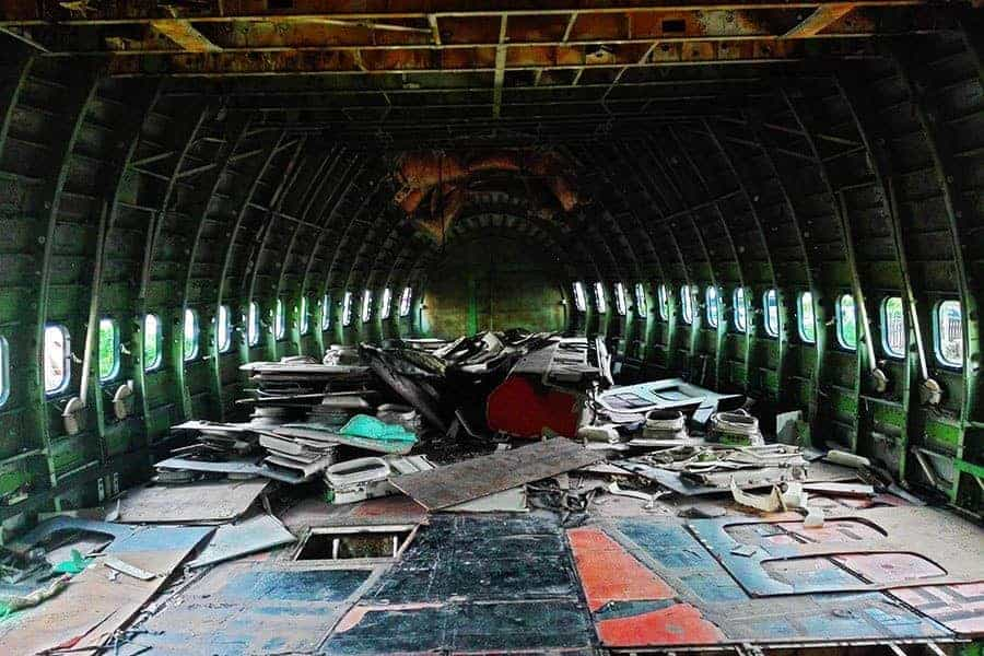Inside-the-main-body-of-an-abandoned-747-at-the-aeroplane-graveyard,-Bangkok,-Thailand